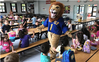 'Literacy Lion' Visits Manetuck